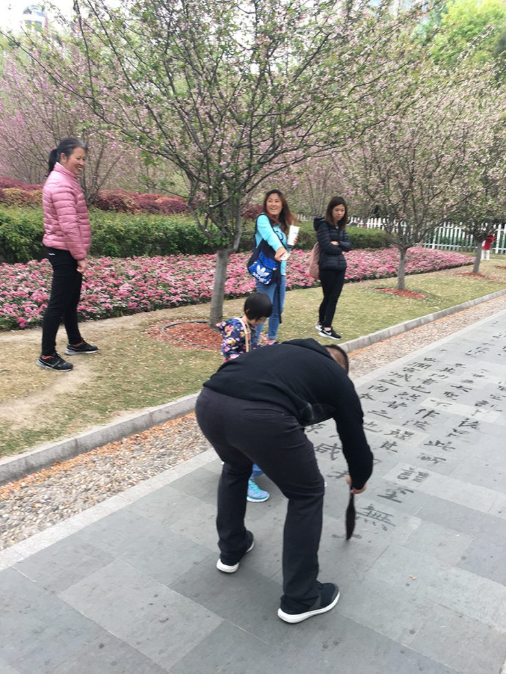 water calligraphy in People's Park