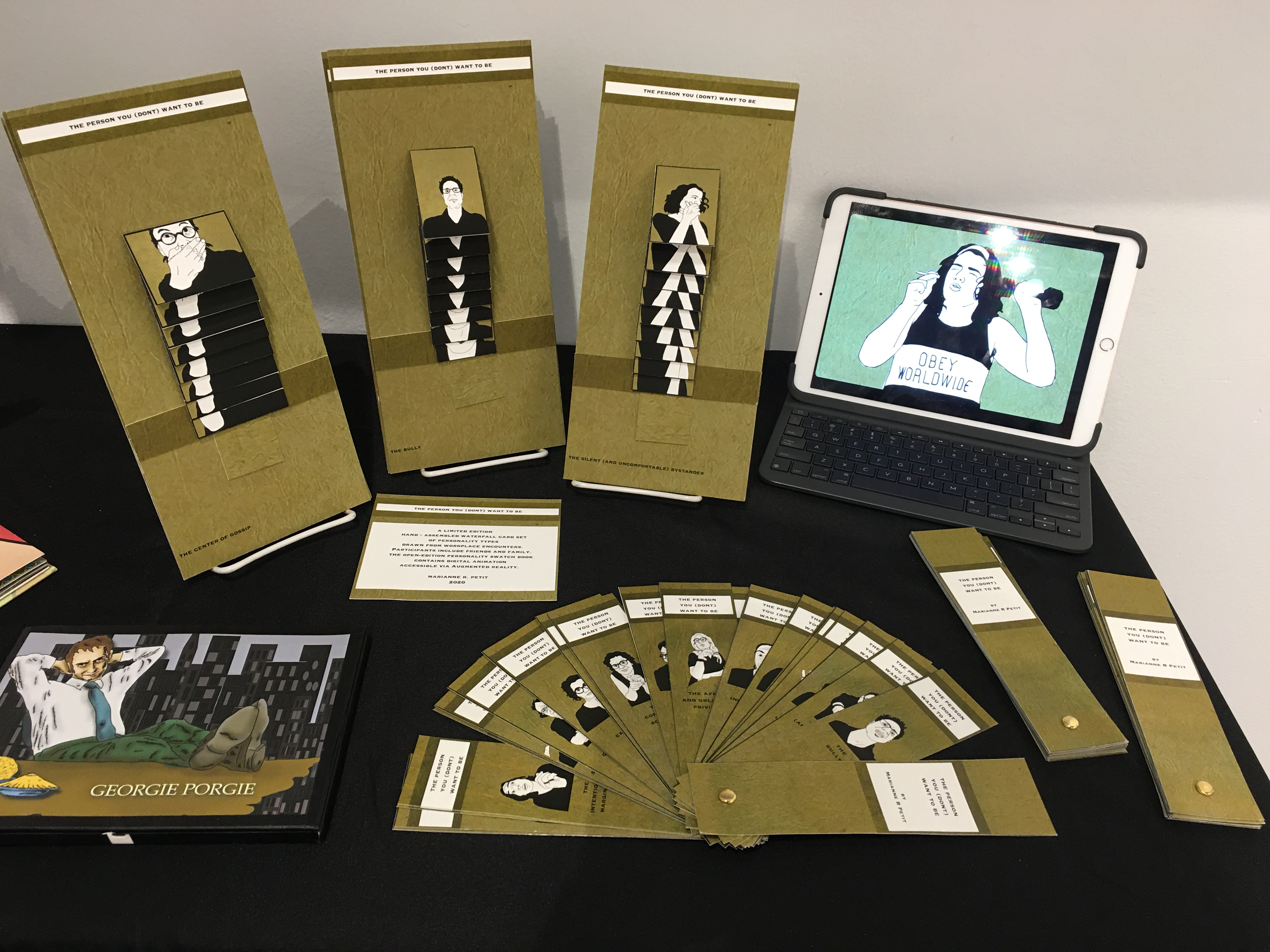 Image of table with several waterfall cards, an iPad playing animations, and several swatch books.